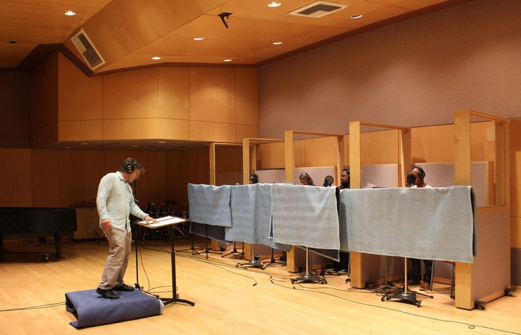 Conductor and Music Director Marc Lowenstein at a INVISIBLE CITIES recording session.