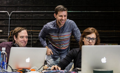 "Yuval Sharon, center, with Jason H. Thompson and Kaitlyn Pietras of the production team during a rehearsal of ""Young Caesar."" Photo by Emily Berl for The New York Times."
