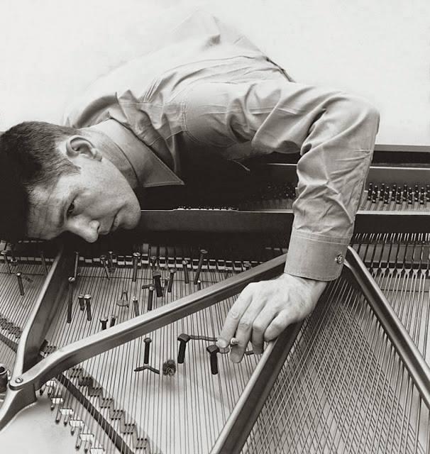 John Cage with a prepared piano