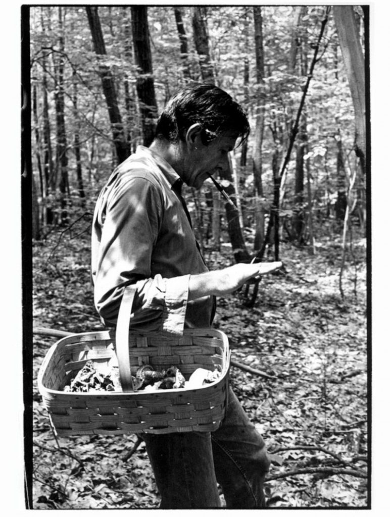 John Cage collecting mushrooms